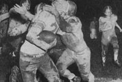 Buffalo player Dick Doll is tackled by Alfred Saxons