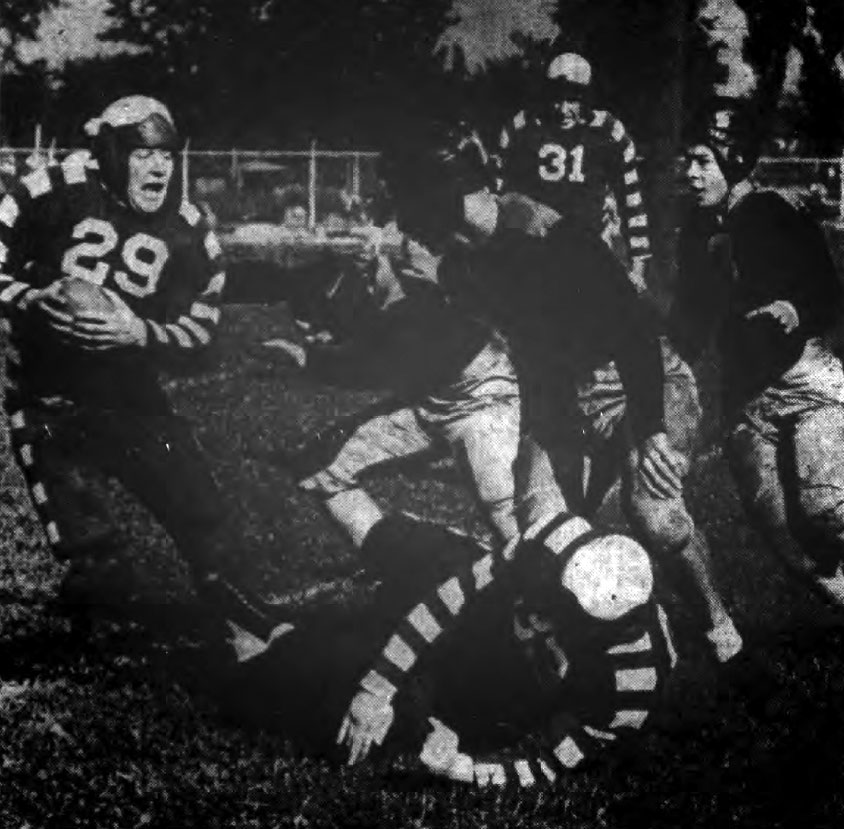 University of Buffalo's Gene Small returns a punt against City College of New York.