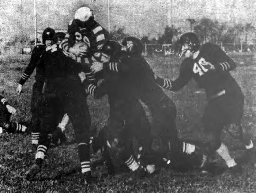 University of Buffalo's Gene Small dives for a yard against Connecticut Huskies linemen.