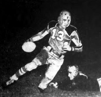 Bob Holmes of Texas Tech runs for 15 yards in Buffalo, NY.