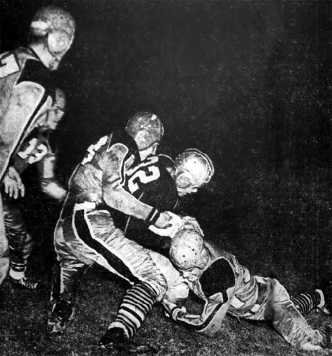 Geno Onder of Duquesne is tackled in Buffalo, NY.