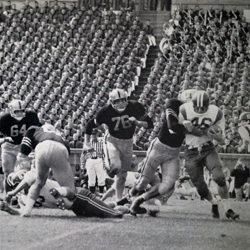Buffalo halfback Skip Maue (#46) is tackled for a loss.